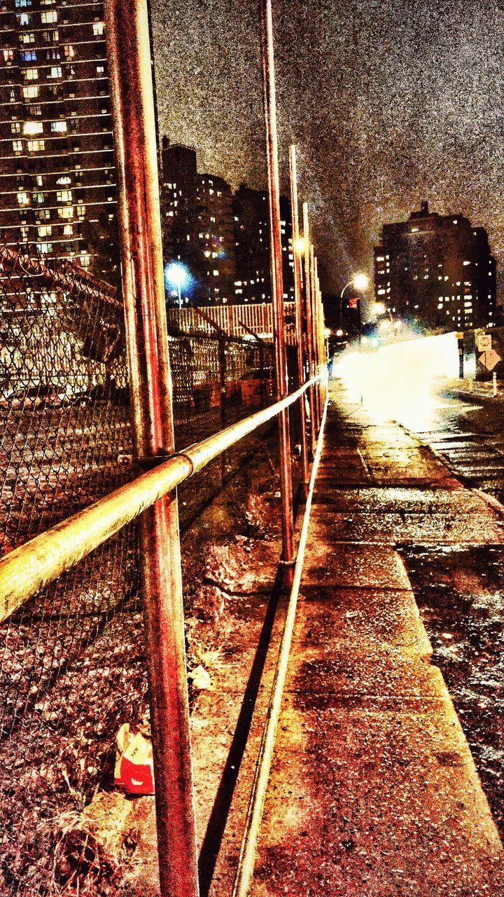 night, transportation, railroad track, illuminated, architecture, built structure, rail transportation, outdoors, building exterior, city, mode of transport, public transportation, no people, sky