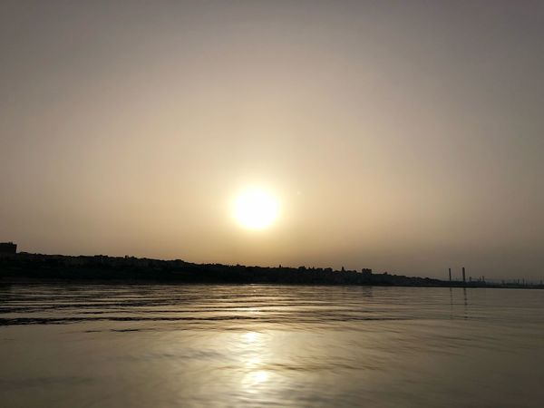 Water Sky Scenics - Nature Sea Tranquility Sunset Beauty In Nature Tranquil Scene Nature No People Sun Sunlight Reflection Beach Non-urban Scene
