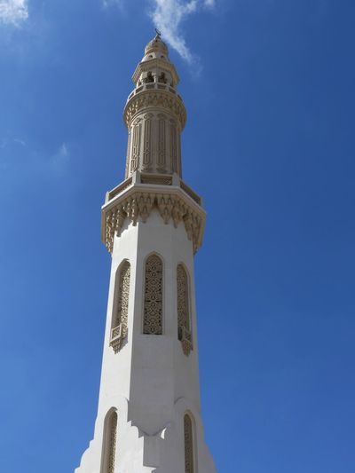 Ornate Minaret at the Mosque opposite The Royal Palace, Dubai, United Arab Emirates 2019 Dubai UAE 2019 Mosque Religion Islam Islamic Architecture Minaret Place Of Worship Ornate Blue Sky Sunlight And Shade No People Low Angle View Belief Tower Spirituality Tall - High Arabic Architecture Place Of Prayer Full Frame Composition Outdoor Photography Tourist Destination Travel
