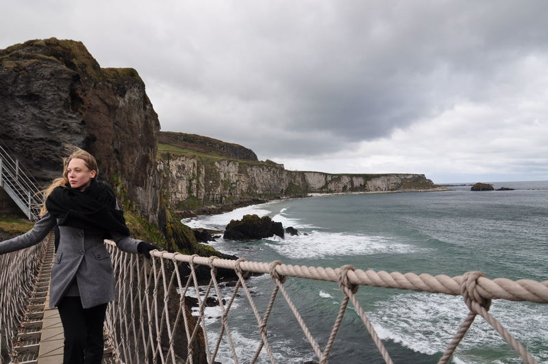 woman traveling to northern ireland Beauty In Nature Cliff Day Full Length Irish Sea Nature Northern Ireland One Woman Only Outdoors Sea Travel Travel Destinations Travel Photography Woman Women Around The World Long Goodbye
