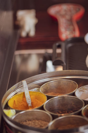 A selection of ingredients and food items at a kitchen - Indian cuisine. Food And Drink Food Kitchen Utensil Indoors  Container Close-up Freshness No People Focus On Foreground Still Life Household Equipment Spice Selective Focus Choice Bowl Healthy Eating Metal Variation Wellbeing Indian Cuisine Curry