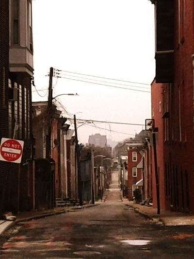 there are so many pictures waiting to be takin in the city. city flavors. City Cable Red Power Line  Architecture Building Exterior Sky Built Structure Empty Road The Way Forward Diminishing Perspective vanishing point Passageway Leading