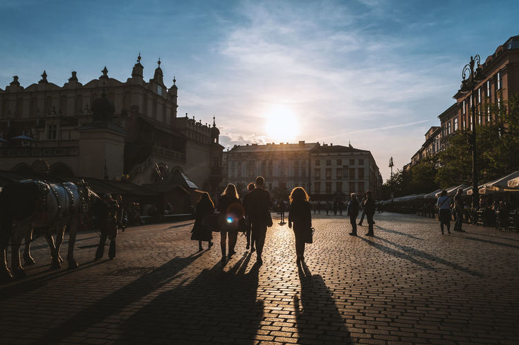 Architecture Building Exterior Built Structure City Day Domestic Animals Large Group Of People Mammal Men Outdoors People Real People Sky Sun Sunlight Sunset Travel Destinations