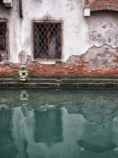 Abandoned built structure with reflection