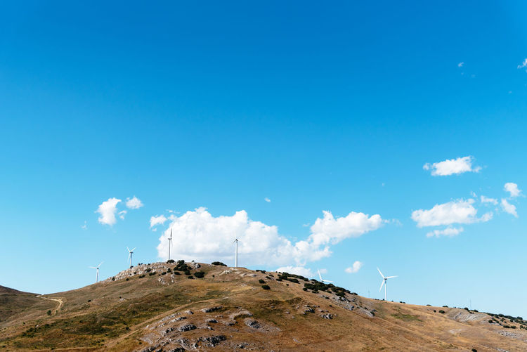 Clouds over mountain against blue sky Sky Cloud - Sky Nature Blue Environment Scenics - Nature Landscape Day Mountain Tranquil Scene Land Beauty In Nature No People Tranquility Copy Space Non-urban Scene Outdoors Sunlight Idyllic Hill Copy Space