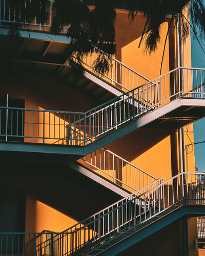Low angle view of staircase at sunset