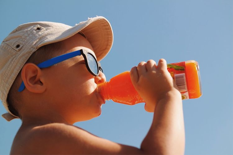Summer freshness... Leisure Activity Holding My Favorite Photo Found On The Roll Childhood Memories Childhood Having Fun Colour Of Life Close-up Vscocam Enjoying Life Drinking Juice Fresh On Eyeem  Freshness Delicious Orange Juice  Orange Color Made In Romania Focus On Foreground Selective Focus Sunglasses Children's Portraits Kids Being Kids Dramatic Angles