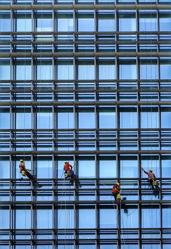 People working in glass building