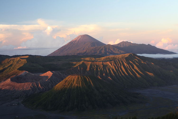 View of volcanic mountain during sunset