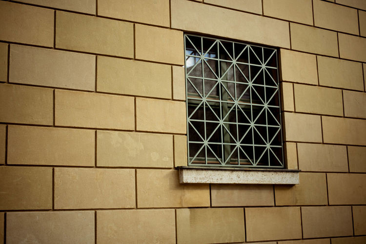 Low angle view of window on building wall