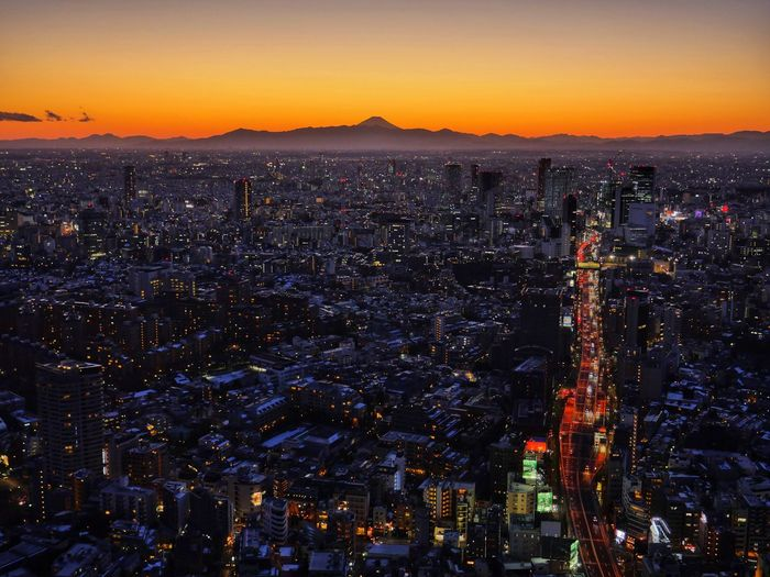 Tokyo and Mount Fujii. Cityscape Sunset City Illuminated Night Skyscraper Urban Skyline Horizon Sky Nightlife Awe Scenics Travel Destinations Landscape Modern Outdoors Building Exterior Aerial View The Traveler - 2018 EyeEm Awards Capture Tomorrow