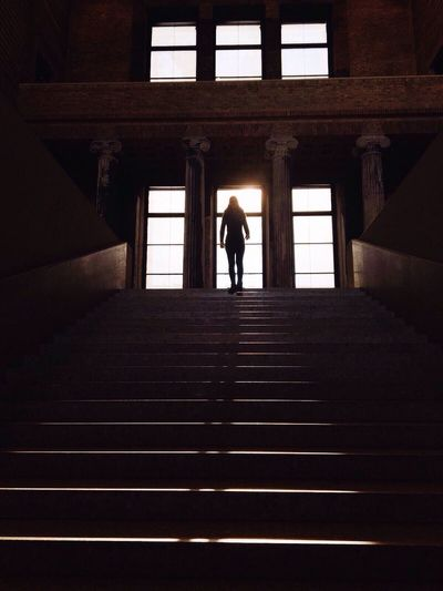 Low angle view of person standing on steps in neues museum