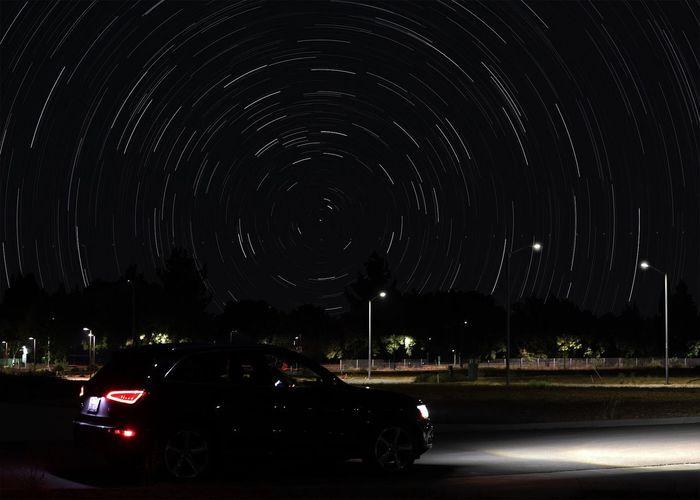 Illuminated car against sky at night