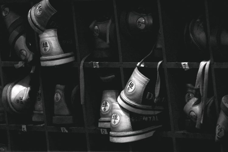 Bowling Shoes waiting for the next pair of feet...... hmmm... Arts Culture And Entertainment Black And White Photography Bowling Bowling Alley Close-up Entertainment Family Time FamilyTime Fun Fun Times Funtimes In A Row Light And Shadow Numbers Part Of Rental Share Shelf Shoes Side By Side Sports Photography Storage Waiting Waiting ... Waiting In Line