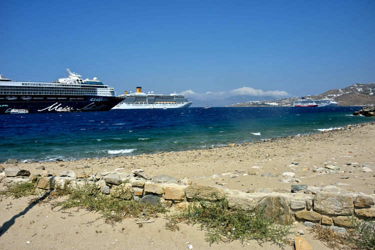 seascape with cruise ships anchored in Mykonos Water Sea Sky Nautical Vessel Beach Land Nature Ship Day Transportation Beauty In Nature No People Scenics - Nature Mode Of Transportation Built Structure Tranquility Architecture Outdoors Tranquil Scene Cruise Ship Yacht Passenger Craft Costa Deliziosa Mein Shiff Cruising Travel Mykonos,Greece Sandy Beach Seascape