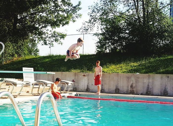 Children playing in swimming pool
