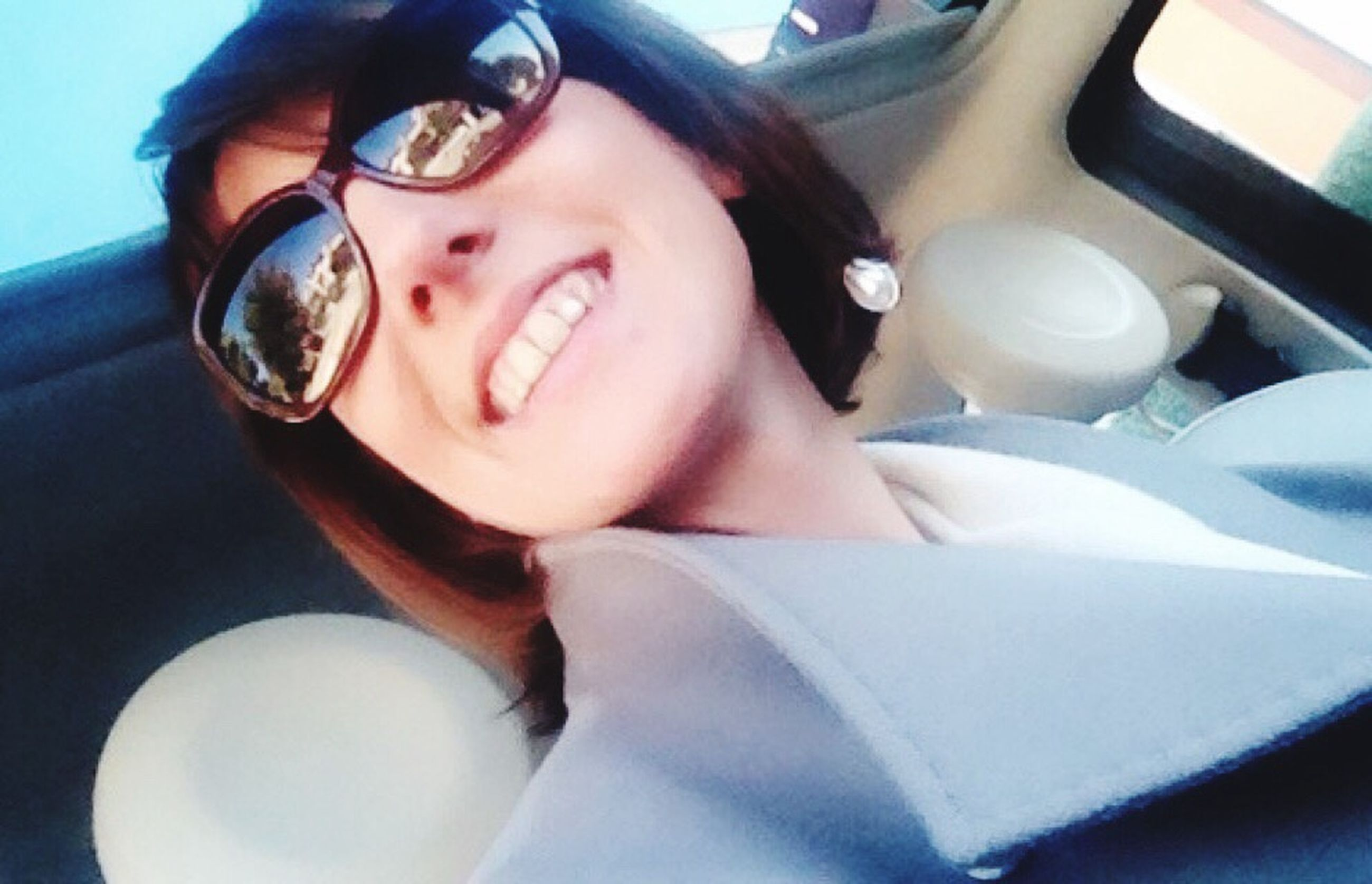 indoors, sunglasses, car, person, close-up, looking at camera, land vehicle, food and drink, lifestyles, childhood, portrait, transportation, reflection, eyeglasses, table, leisure activity, sitting, front view