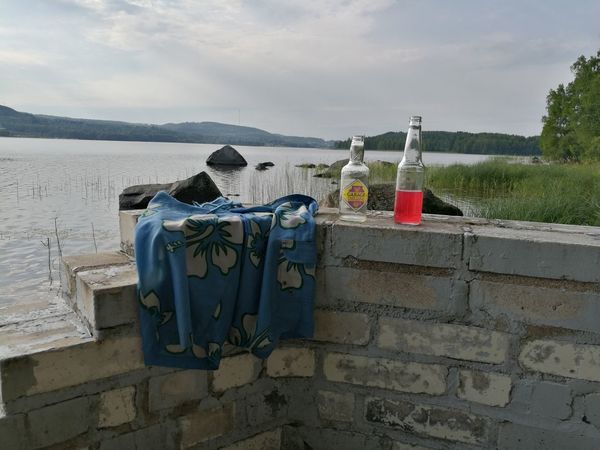At friend's parents cottage after sauna and swimming 😊 Outdoors Sea Sky Lake Lakeside Jyväskylä Finland August Summer Photography Weekend Reflection Clouds Sky Skylovers Photo Drinks Drinks And Bottles
