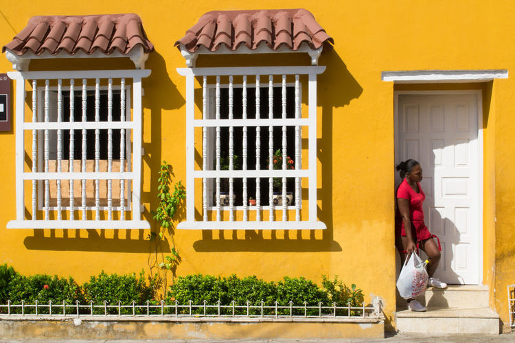 Architecture Building Exterior Built Structure Cartagena Cartagena, Colombia Colombia Colombia ♥  Day EyeEm Best Shots Full Length Lifestyles One Person Outdoors People Plant Real People Residential Building Yellow