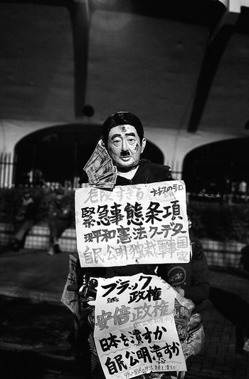 The Photojournalist - 2016 EyeEm Awards Protest Protesters Photojournalism Japan 35mm Film Filmisnotdead Monochrome Streetphotography Street Photography Street Life Streetphotography_bw Film Photography