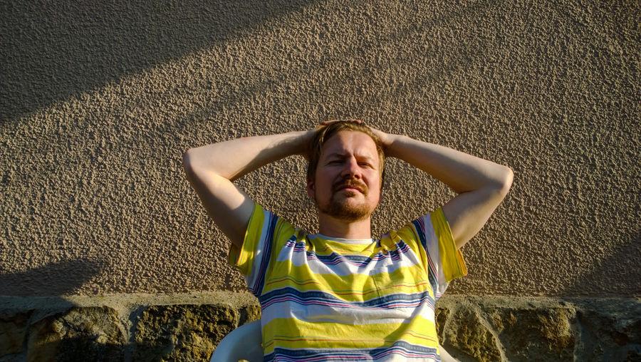 Man Relaxing In Sunshine