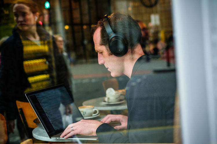 Portrait of woman working with laptop
