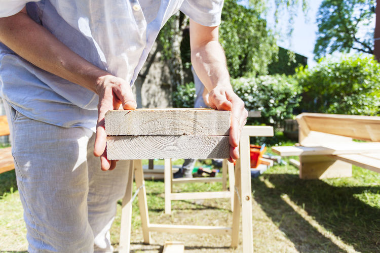 Care Carpentry Work Construction Construction Site DIY Do It Yourself Hands Home Improvement Working Accuracy Building Building Site Carpenter Carpentry Close-up Craft Craftmanship Garden Handmade Outdoors Precision Project Real People Tools Wood - Material