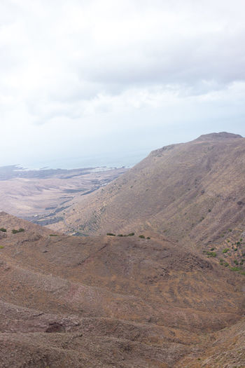 Arid Climate Beauty In Nature Canary Islands Cloud - Sky Day Landscape Lanzarote Mountain Mountain Range Nature No People Outdoors Physical Geography Scenics Sky The Great Outdoors - 2017 EyeEm Awards Tranquil Scene Tranquility Lost In The Landscape Perspectives On Nature