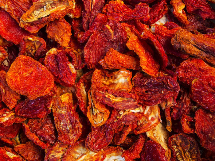 Full frame shot of dried tomatoes for sale at market stall