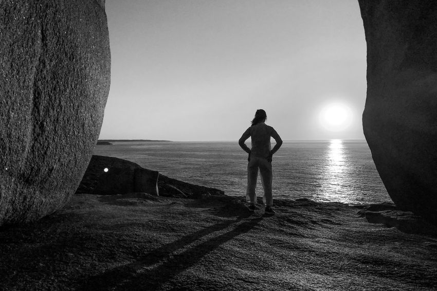 Sunrise at Remarkable Rocks Black And White Light And Shadow Monochrome Sea Real People Horizon Over Water Standing Water One Person Beach Nature Leisure Activity Lifestyles Outdoors Scenics Beauty In Nature Day Clear Sky Sky The Traveler - 2018 EyeEm Awards