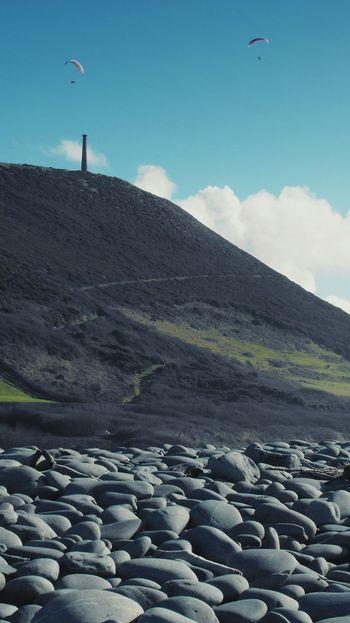 ... human Flight ... Sky Landscape Outdoors Travel Destinations Flying Aberystwyth Column Hill Paragliders Paragliding Wales Pebbles Beach Stones пляж галька холм Playa Pais De Gales