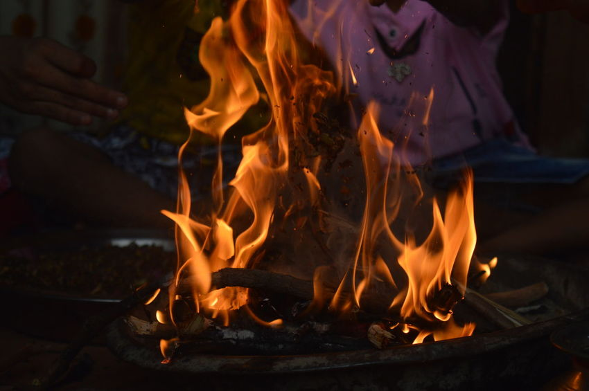 without filter.. Fire Hawan EyeEmNewHere Religion Worship EyeEm Gallery EyeEm Selects EyeEm Eyeemphotography Eyeem Market EyeEm Team Wood Mangowood Naming Ceremony Hawan Kund Spirituality Village Indianvillage Occasion Flame Heat - Temperature Motion Burning Smoke - Physical Structure Illuminated Close-up Ash The Photojournalist - 2018 EyeEm Awards A New Perspective On Life