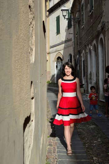TakeoverContrast Girl At Street Red Alley Looking At Camera Person City Life Streetphoto Street Life Italy❤️ Italyiloveyou Italy_vacations MedievalTown Medieval City