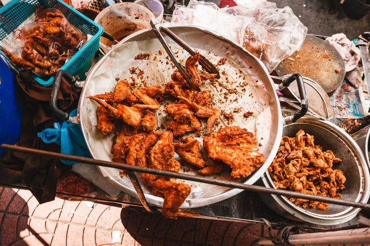 High angle view of fried chicken for sale at market stall