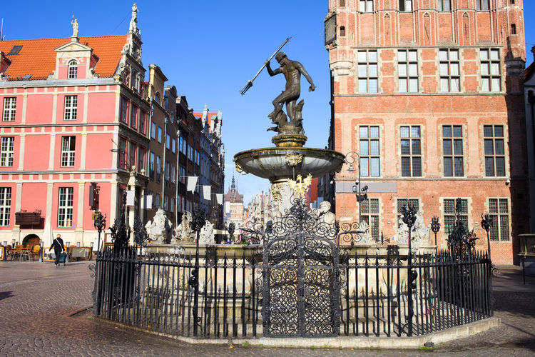 Neptune Fountain with bronze statue of the Roman God of the Sea in Old Town of Gdansk city in Poland Fountain God Historical Building Historical Monuments Neptune Neptune Fountain Old Town Poland Sightseeing Architecture Building Built Structure City Europe Famous Place Gdansk History Landmark Monument Mythology Sculpture Statue Town Hall Travel Travel Destinations