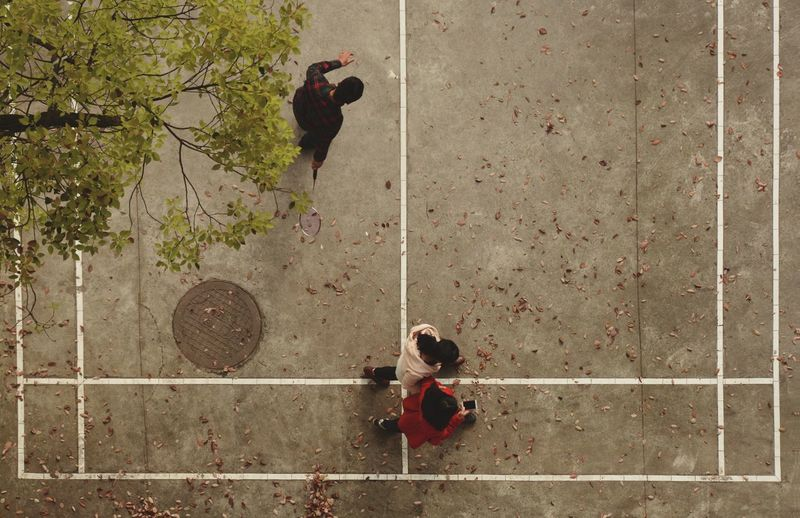 High Angle View Of Children Playing At Badminton Court