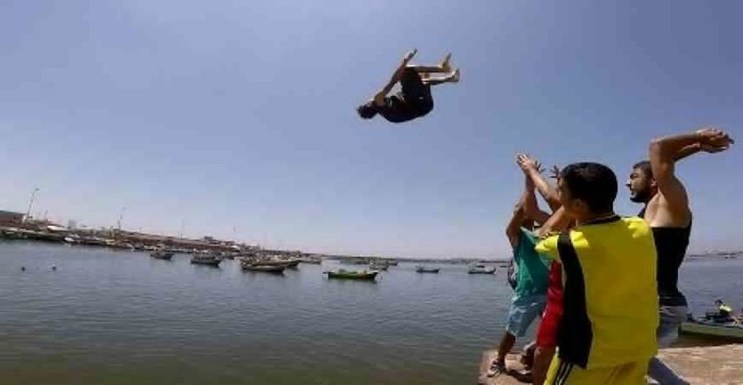 Parkour Water Togetherness Adults Only Outdoors Lifestyles Young Adult Real People Sky Day Gaza-Palestine Stories From The City