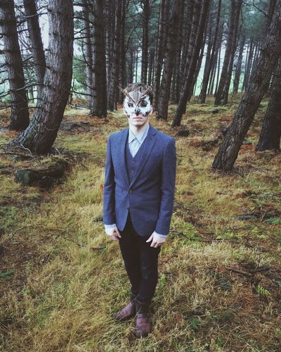 Owl man. Northumberland, England. Photo by Tom Bland. Forest Trees Standing WoodLand Nature Person IPhone IPhoneography Winter Masquerade Rural England Disguise Outdoors Male Man Owl Fantasy Mask Mask - Disguise Masks Costume Figure Identity Anonymous