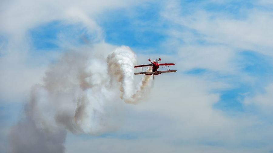 Air Vehicle Airplane Flying Transportation Cloud - Sky Mode Of Transportation Sky Airshow Motion Smoke - Physical Structure on the move Low Angle View Mid-air Plane Day Nature Fighter Plane Teamwork No People Military Airplane Aerobatics Vapor Trail Outdoors Aerospace Industry