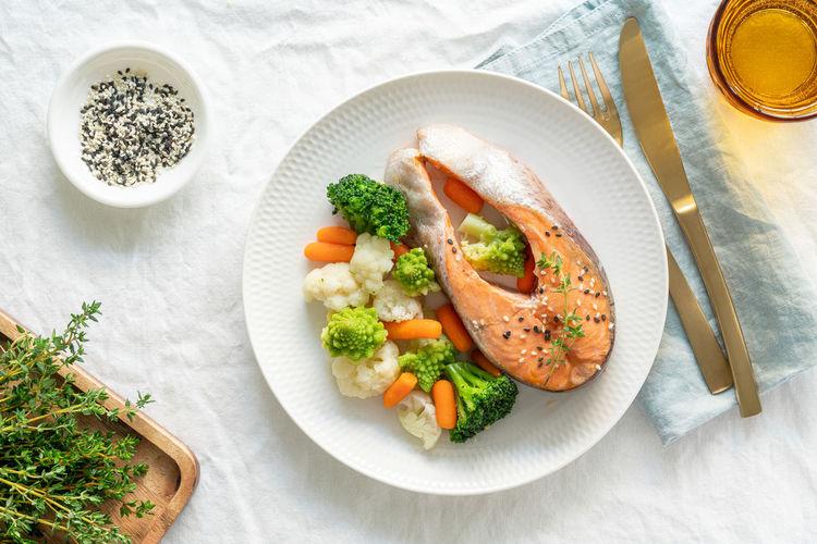 Steam salmon and vegetables, top view. paleo, keto, fodmap, dash diet. mediterranean diet