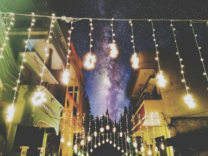 Illuminated Night Celebration Architecture Low Angle View Building Exterior Lighting Equipment Built Structure City Christmas Lights Sky City Life Decoration Nightlife Fairy Lights Tail Light Event