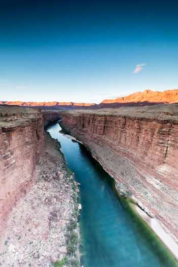 """""""Marble colors"""" A fantastic light is being cast throught the mountains behind Marble Canyon. View from Navajo Bridge over Colorado River, Arizona, USA. http://www.picardo.photography/Portfolio/Landscapes/i-tvGg4Fz/A Arizona Marble Canyon Az USA Beauty In Nature Blue Colorado River Dam Landscape Landscapes Marble Canyon Nature No People Outdoors River Riverscape Scenics Sky Tourism Tranquil Scene Tranquility Travel Destinations Water"""