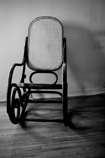 Chair on floor against wall