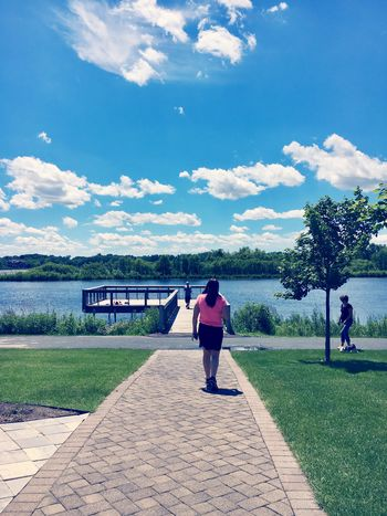 Purgatory Creek Park Sky Full Length Rear View Real People Cloud - Sky Day Walking Outdoors Built Structure Women Tree Nature Beauty In Nature Nature Blue Sunlight Rear View Lakeside Lake View Tranquility