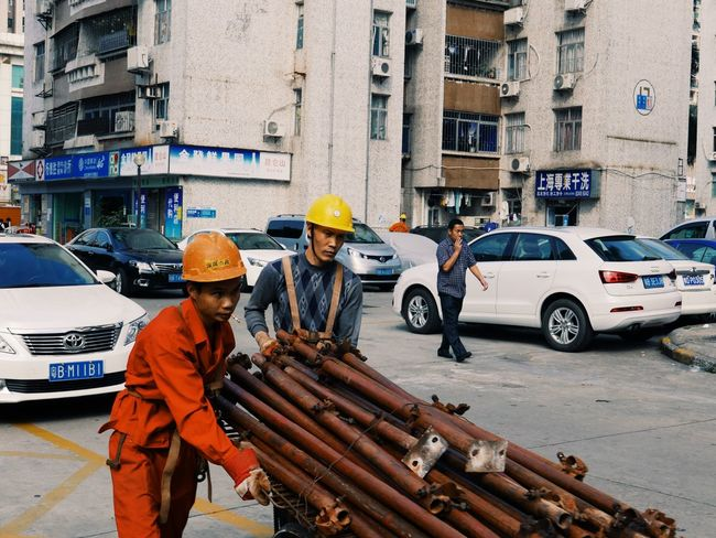 Transportation Teamwork Only Men Standing Occupation Adult Men Day Outdoors Adults Only Building Exterior Working Headwear Real People Helmet Architecture People Protective Workwear Young Adult Hardhat