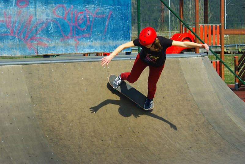 Balance Leisure Activity Lifestyles Light And Shadow Outdoor Photography Motion One Person Outdoors Real People Red Color Red Helmet Skateboard Park Skateboarding Skateboardingisfun Skill  Sport Sports Photography Sports Ramp Woman Power Young Adult Youth Culture