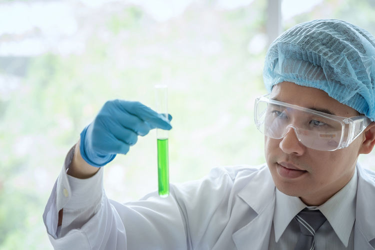 Scientist Analyzing Test Tube At Laboratory