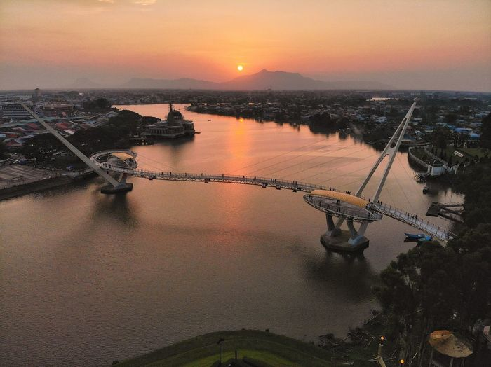 Sunset over the bridge Bridge Bridge - Man Made Structure River Water Waterfront Sky Cityscape Sunset Sunset_collection Sky And Clouds Sunlight Sun View Aerial Shot Getty Images Aerial Photography Dronephotography Holiday Outdoor Travel Travel Destinations Landscape EyeEm Selects Water Sunset Sea Orange Color Sky Shore Boat Horizon Over Water