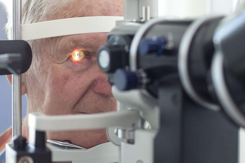 Eye examination at the slit lamp Cataract Córnea Diagnosis Doctor  Examination Eye Eye Doctor  Eye Examination Eyesight Health Lamp Laser Looking Man Oculist Ophthalmologist Ophthalmology Optometrist Optometry Patient Pupil Retina Senior Slit Lamp Test