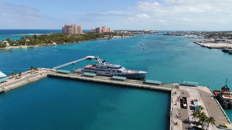 "The superyacht ""Pacific"" at the Nassau, Bahamas cruise terminal 🇧🇸 Aerial View Aerial Photography Dronephotography DJI X Eyeem Travel Travel Destinations Atlantis, Bahamas.  Yacht Superyacht Nassau Nassau, Bahamas EyeEm Selects Architecture Built Structure Building Exterior Sky Sea Water High Angle View Nautical Vessel Harbor Outdoors"
